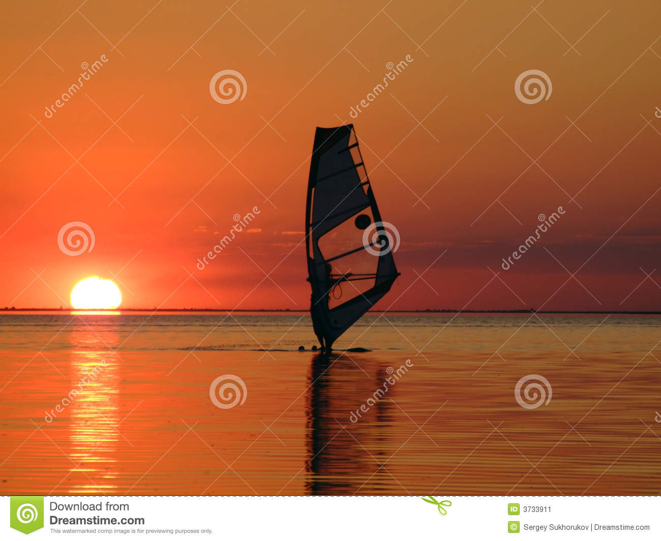 Silhouette of a windsurfer on waves of a gulf 2