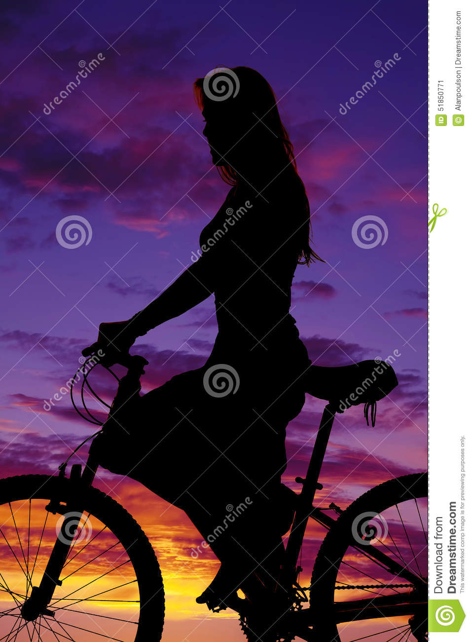 Silhouette of a woman on a bike up close
