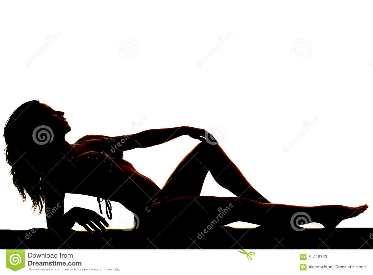 Silhouette of a woman in a bikini lay back black and white