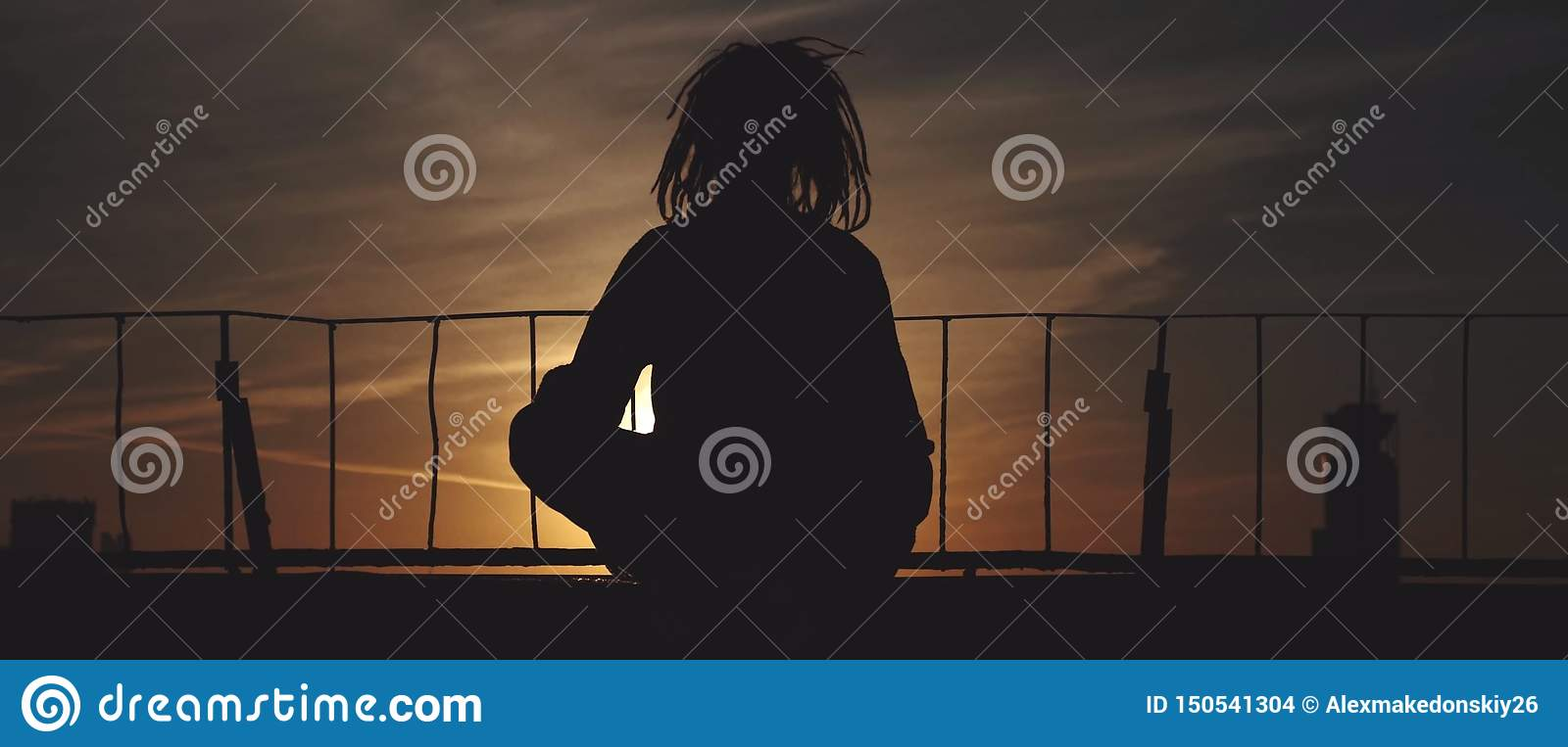 Silhouette of woman on the bridge