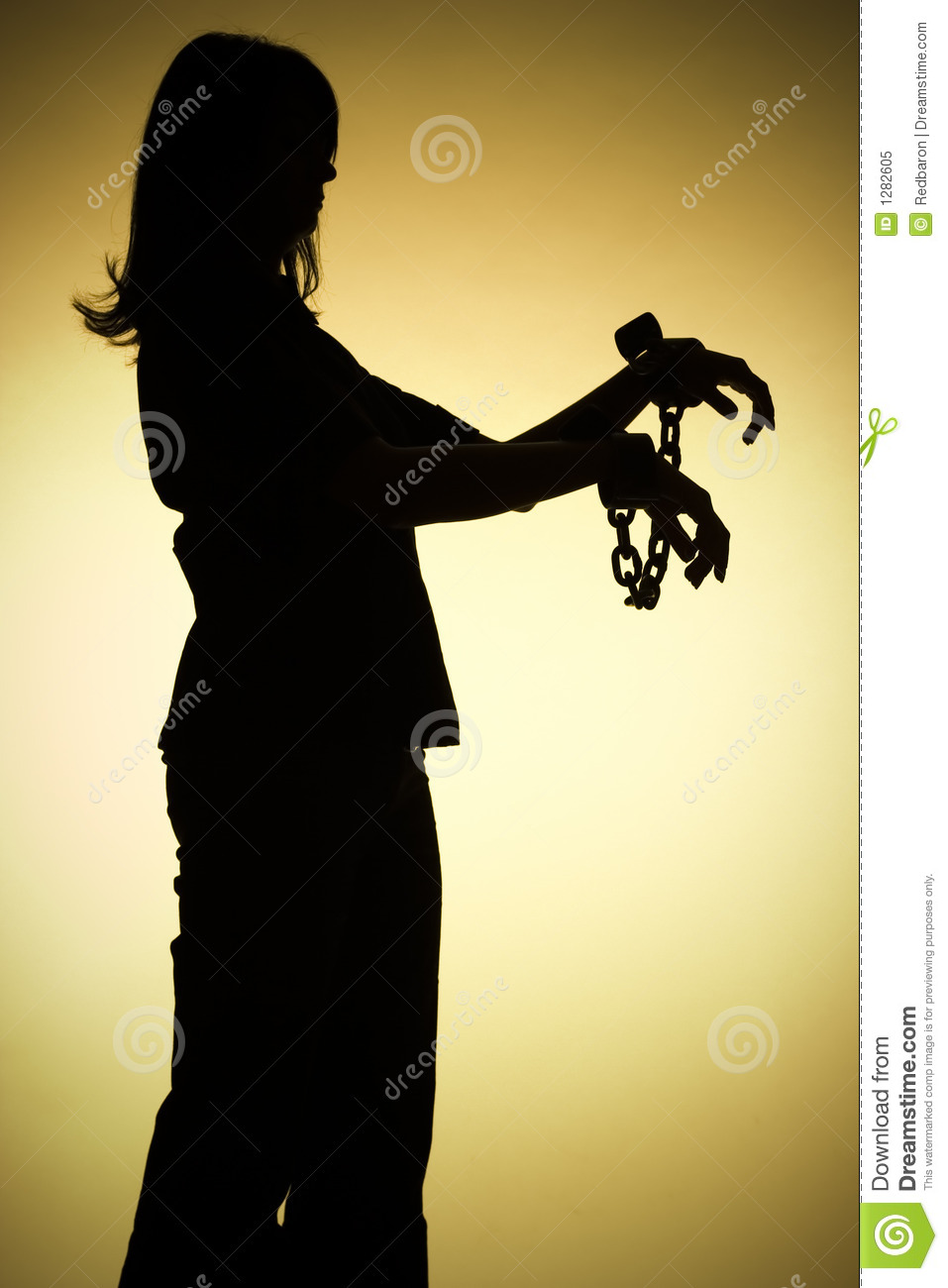 Silhouette of woman with chains