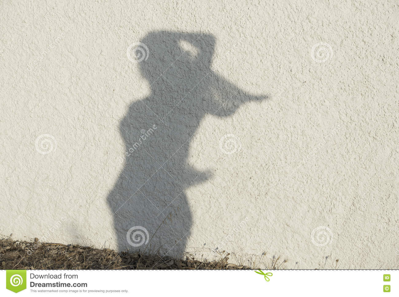 Silhouette of woman figure on natural wall background.Women figure on a wall, artistic photo. Contrast, silhouette of girl figure