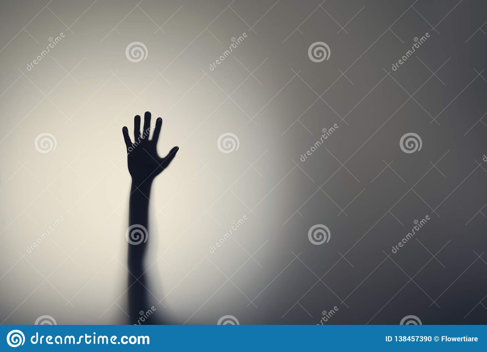 Silhouette of woman hands behind glass door. Concept of depression, fear, panic attacks