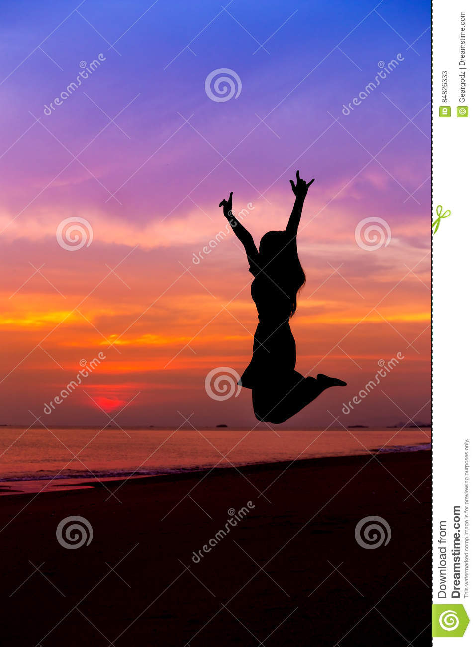 Silhouette of woman jumping with hands up and showing I LOVE YOU