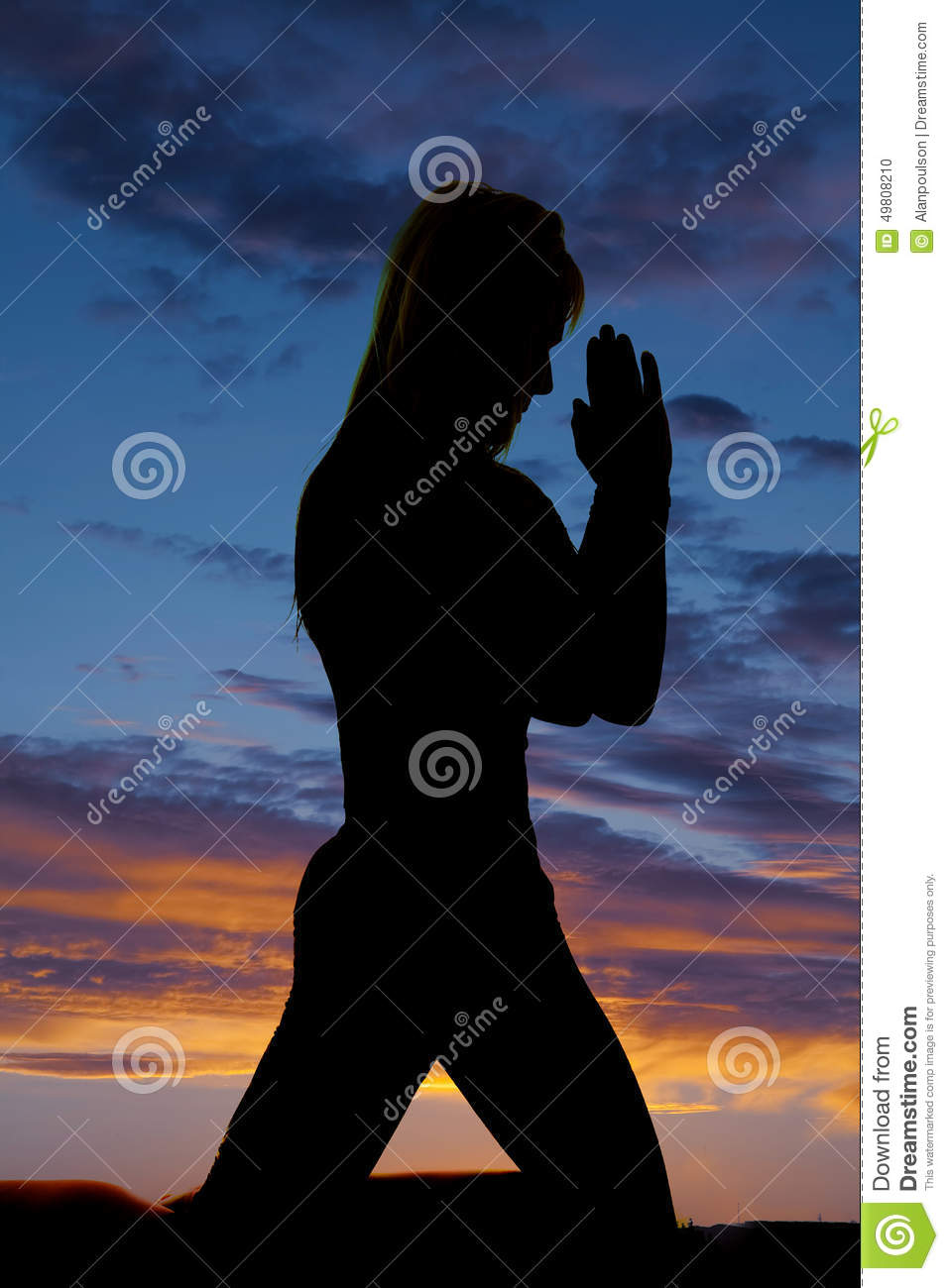 Silhouette of woman kneel and pray