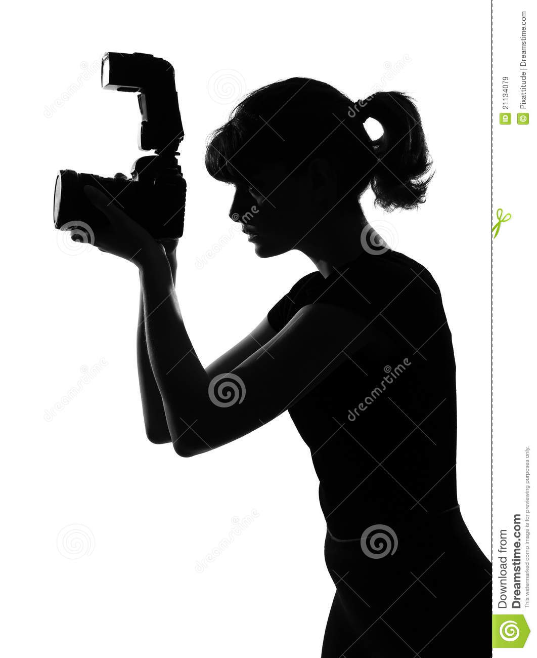 Portrait silhouette in shadow of a young woman photographer holding a ...