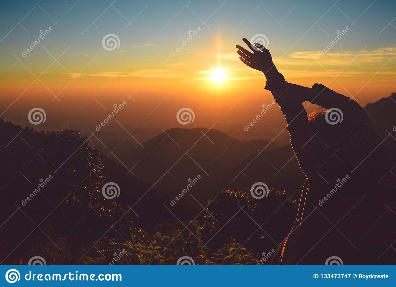 Silhouette Woman Rising Hands On Mountain In Morning With