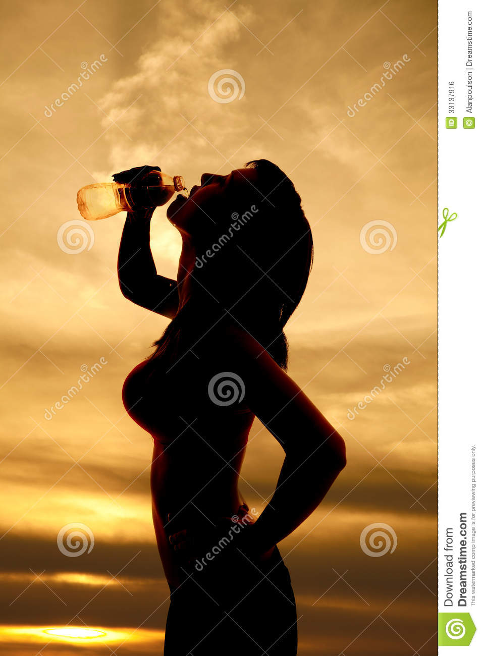 silhouette woman in sports bra drink water royalty free stock image