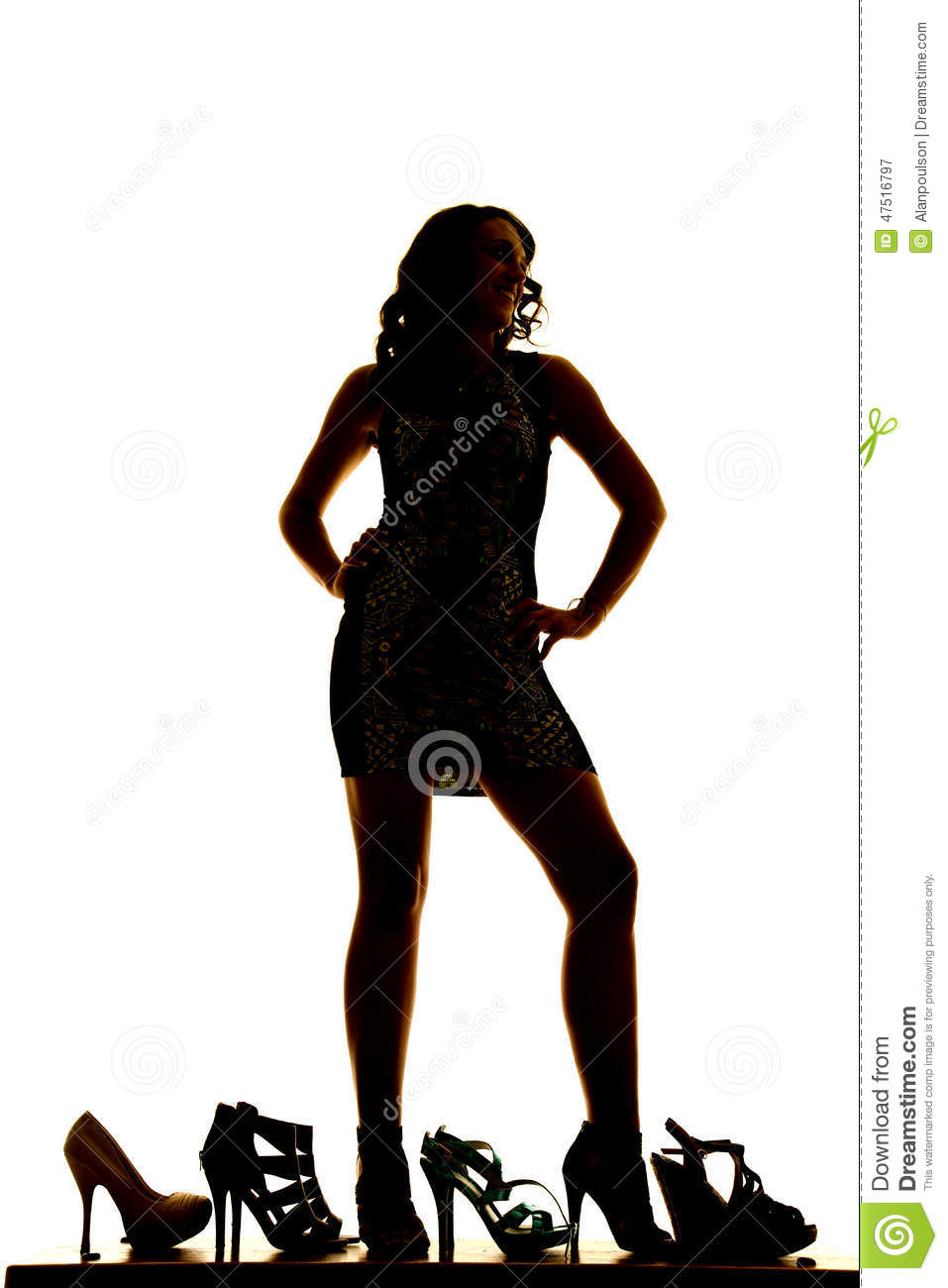 Silhouette Woman Standing Lots Of Shoes Stock Photo