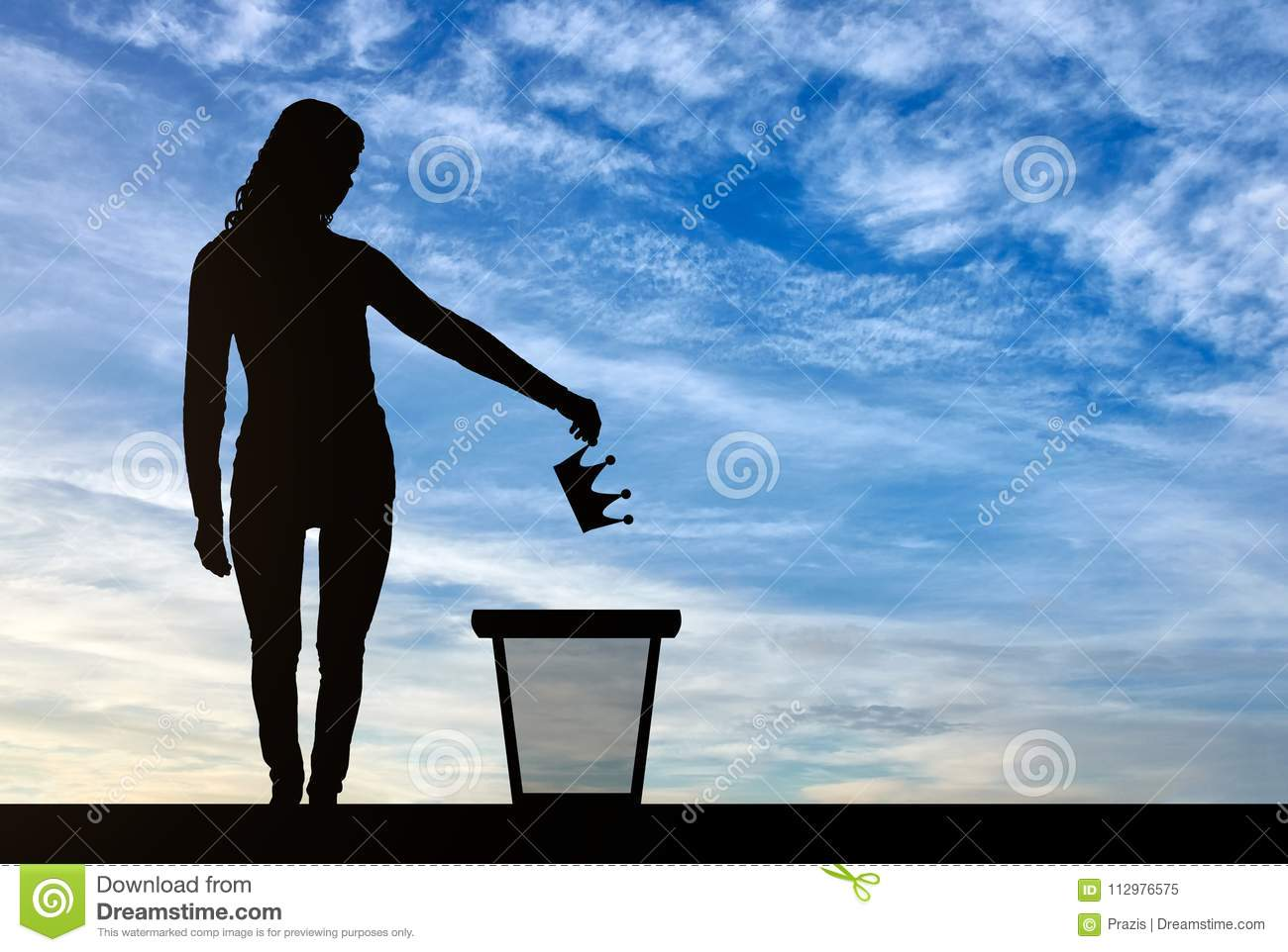 Silhouette of a woman throwing a crown in a garbage bin