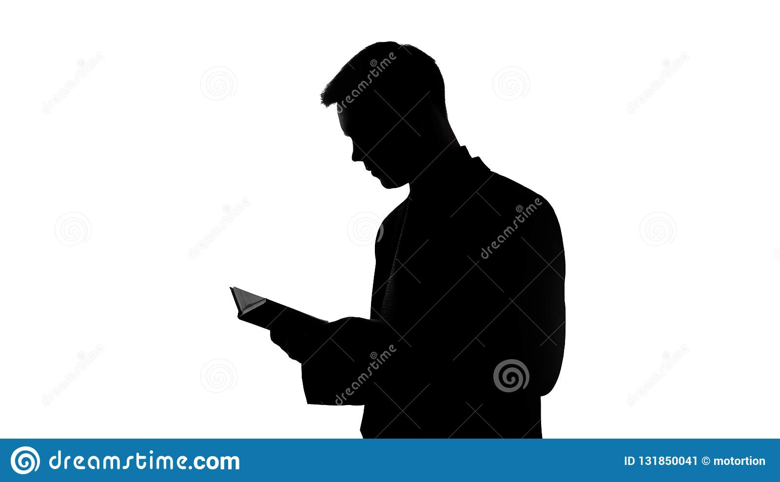 Silhouette of young businessman reading book, planning startup, ideas for future