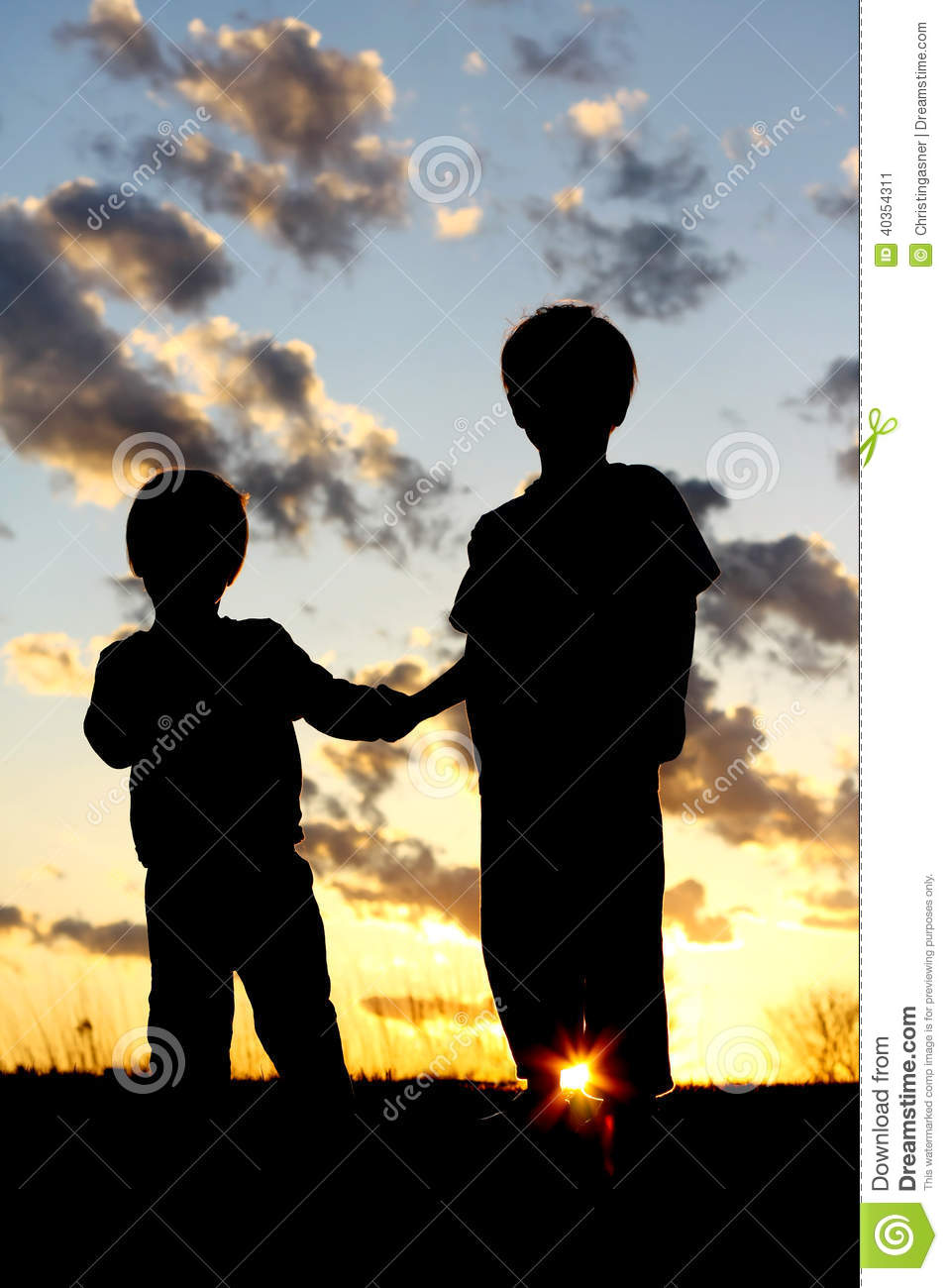 Silhouette Young Children Holding Hands At Sunset Stock ...