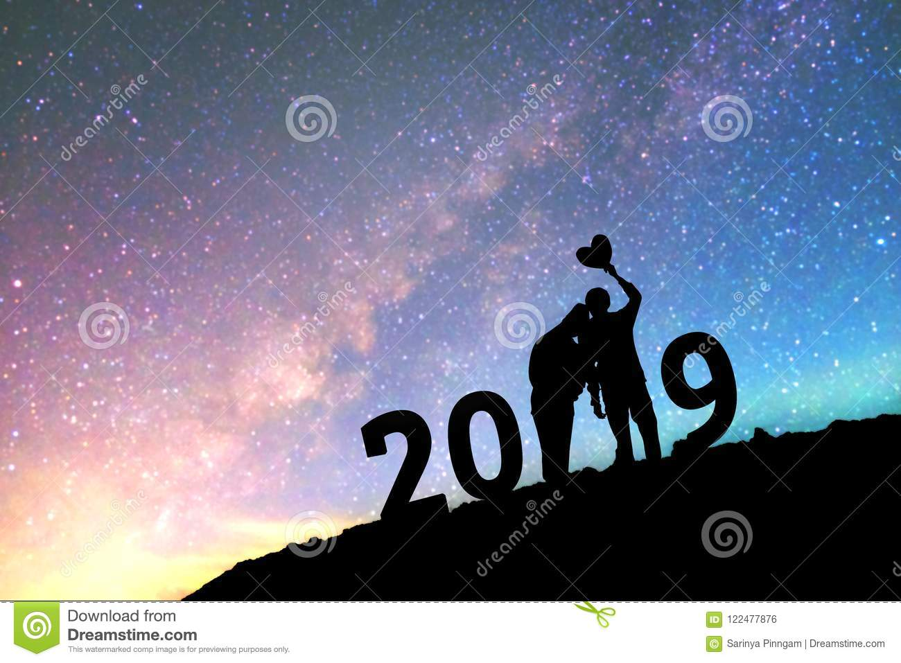 silhouette young couple happy for 2019 new year background on t
