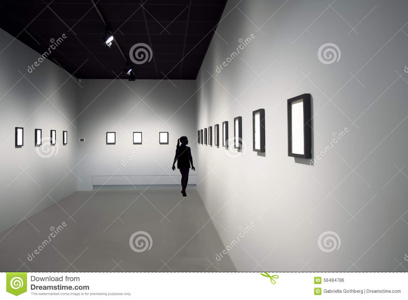 Silhouette of young girl at art exhibition