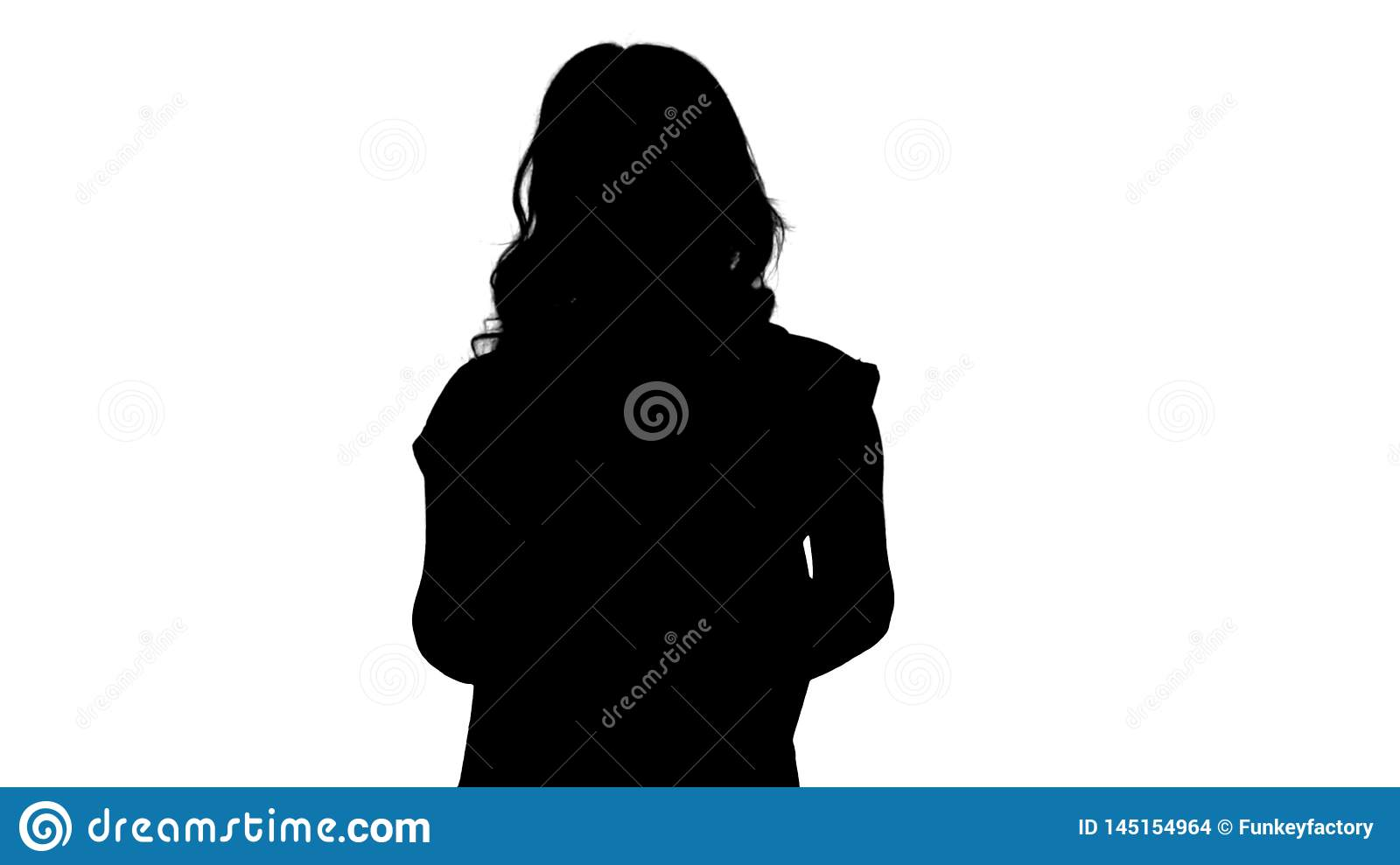 Silhouette Young good-looking woman in casual T-shirt with backpack and jeans walking.