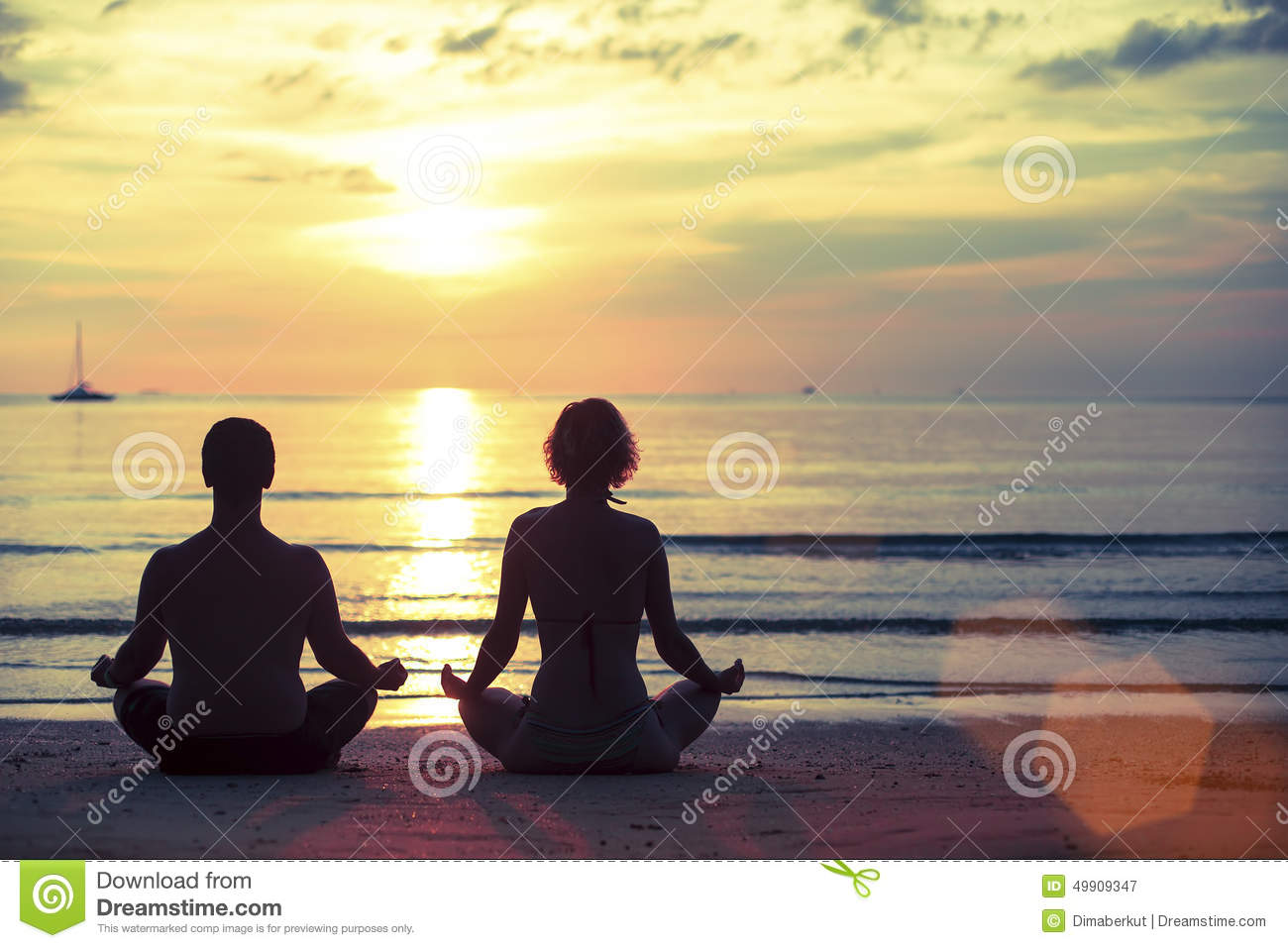 Silhouette of young man and woman practicing yoga in the for Best vacations in december for couples