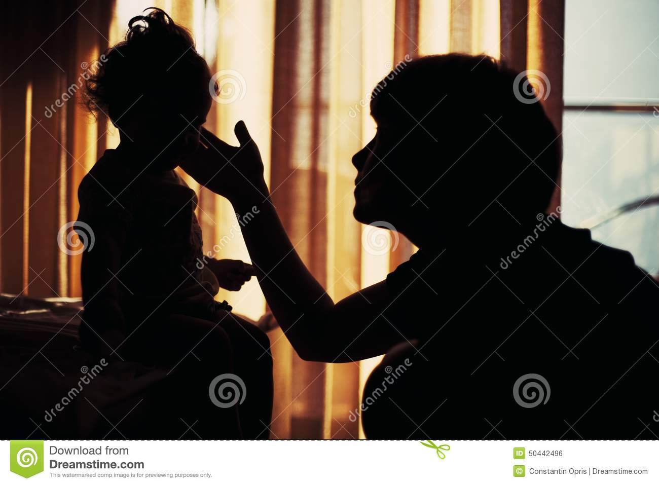 Silhouette of young woman and her child