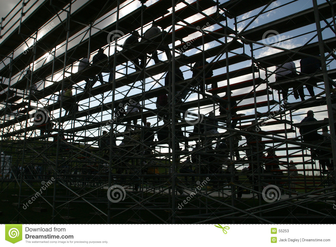 Silhouetted people on bleachers