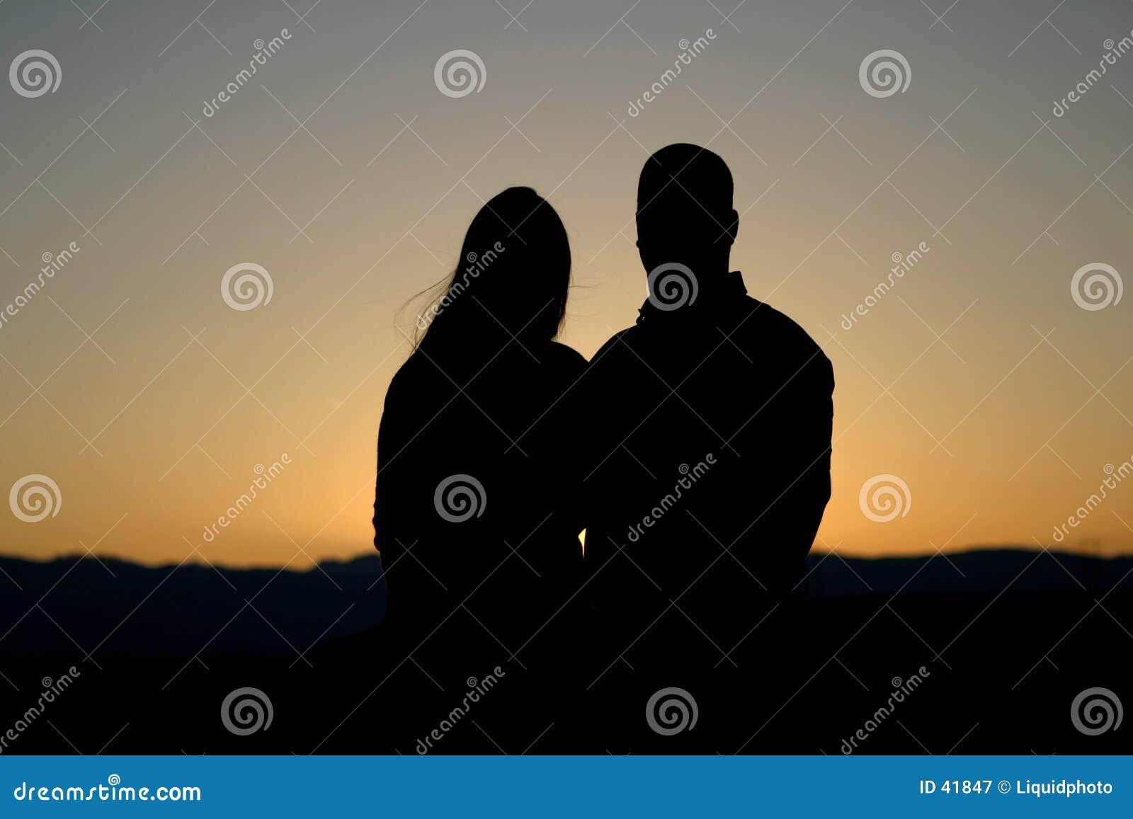 Silhouettekvinna för 2 man