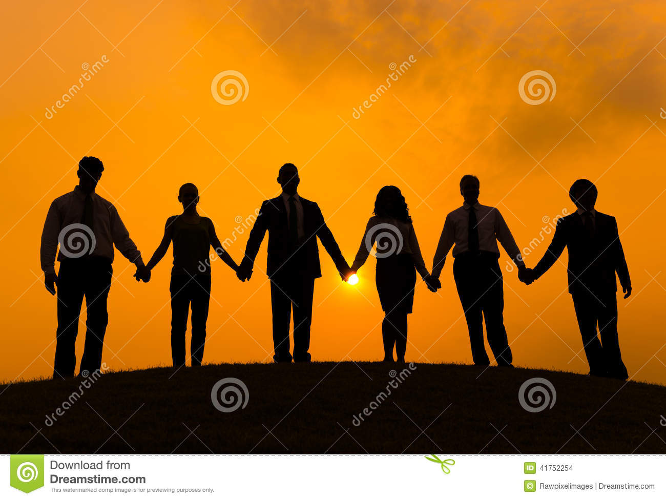 Silhouettes of Business People Holding Hands Outdoors