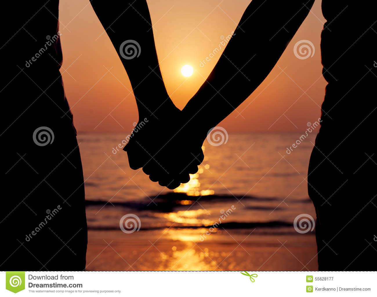 Silhouettes couples holding hands