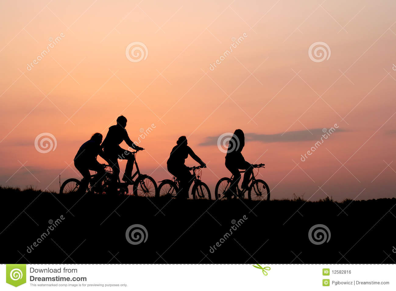 Silhouettes of a family on a bikes