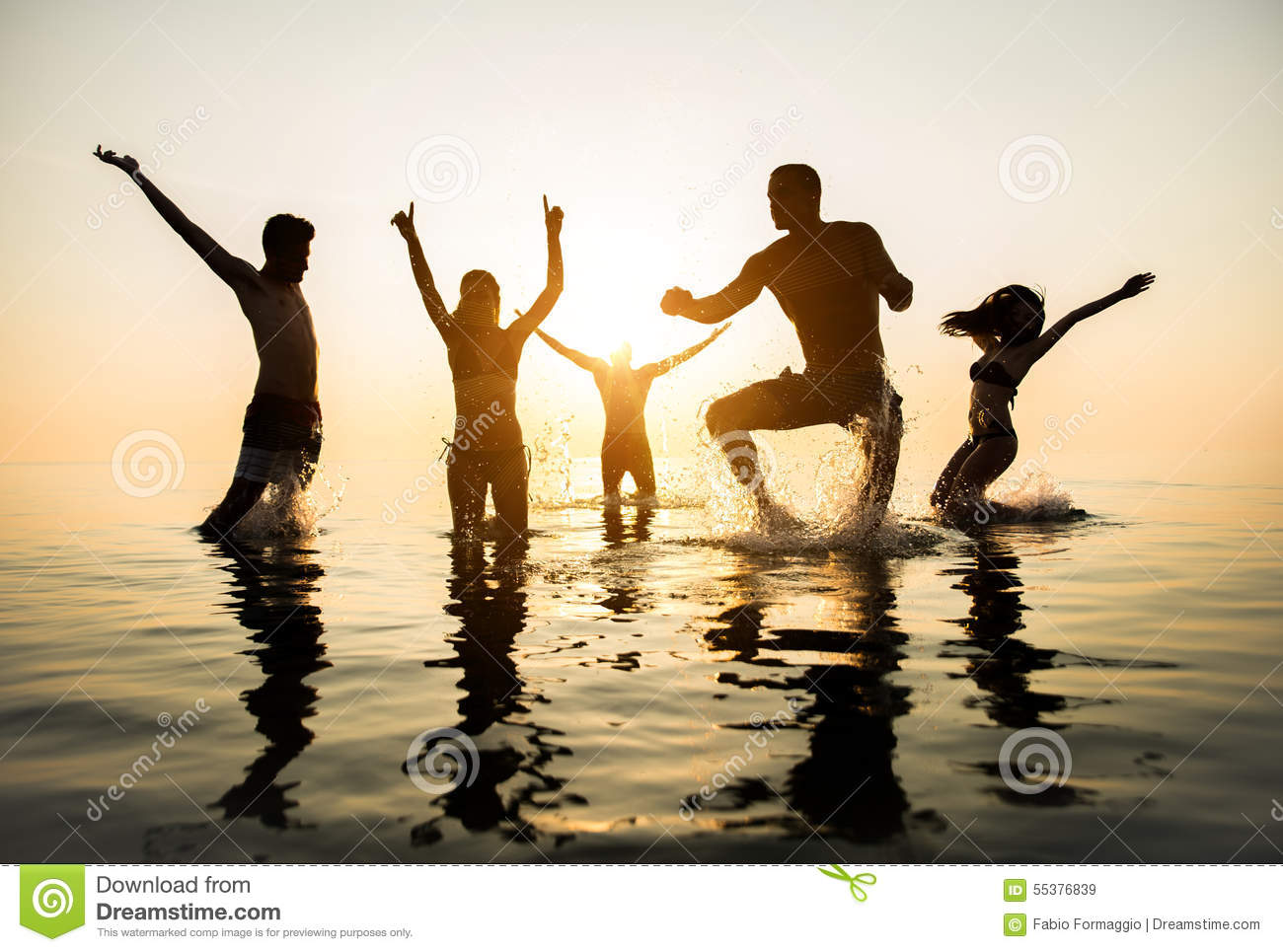 silhouettes-happy-people-group-friends-jumping-to-water-sunset-active-dancing-having-fun-beach-vacation-55376839.jpg