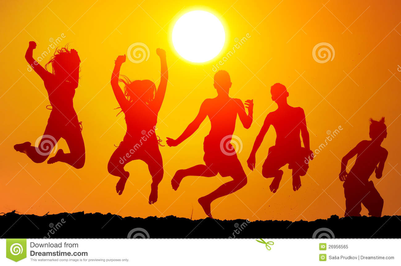 Silhouettes of happy teenagers jumping high