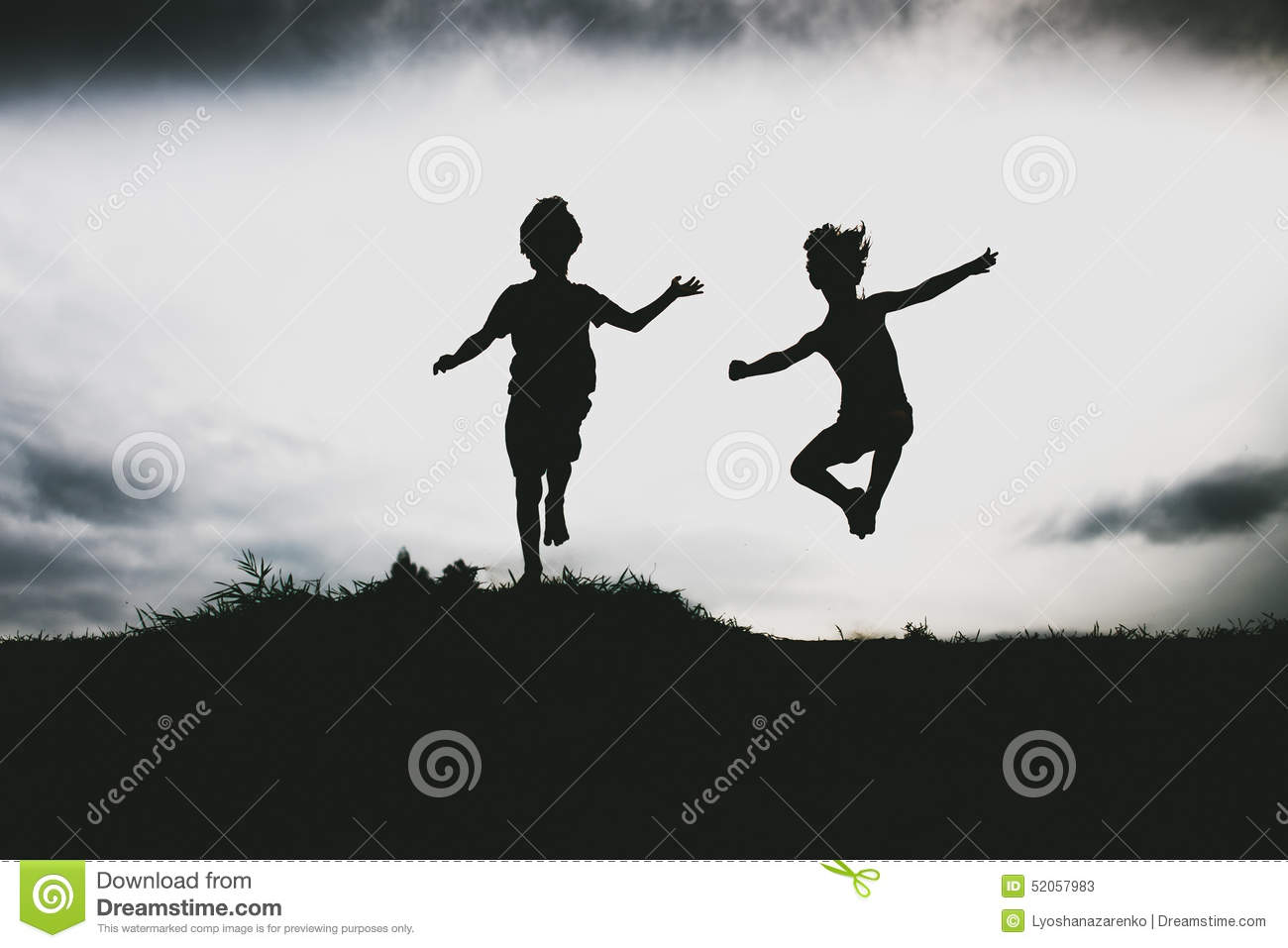 Silhouettes Of Kids Jumping From A Sand Cliff At The Beach