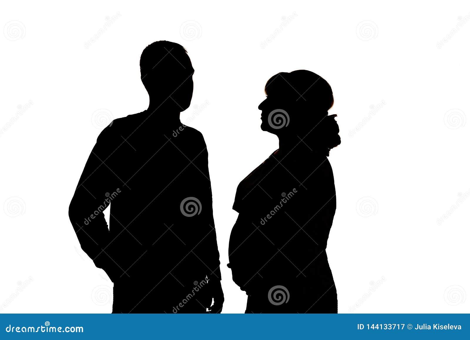 Silhouettes noires sur le fond blanc En isolation
