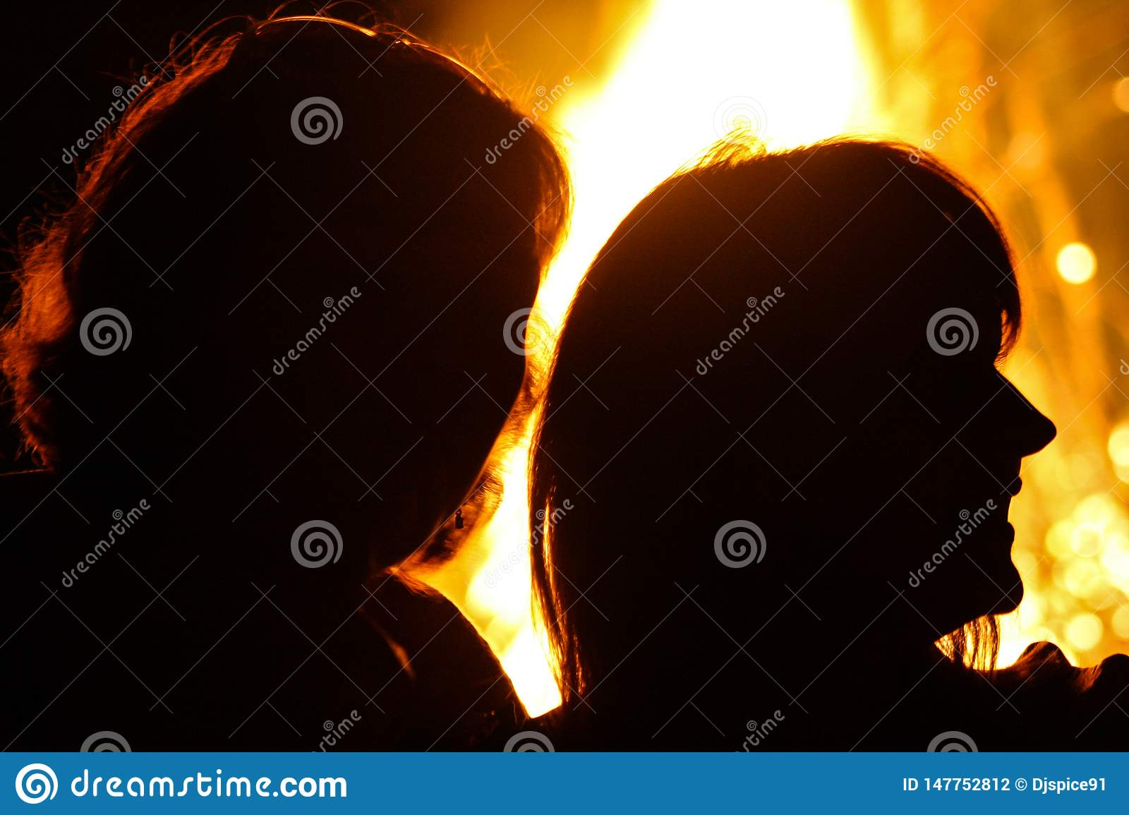 Silhouettes of people on a fire background