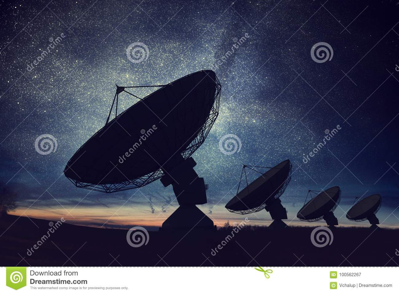 Silhouettes of satellite dishes or radio antennas against night sky. Space observatory