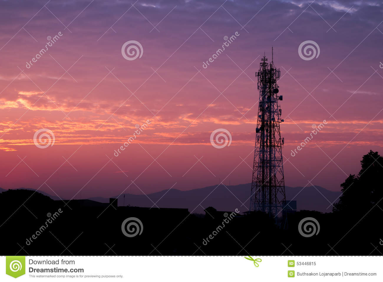 Silhouettes telecommunication tower at sunrise and twilight sky.