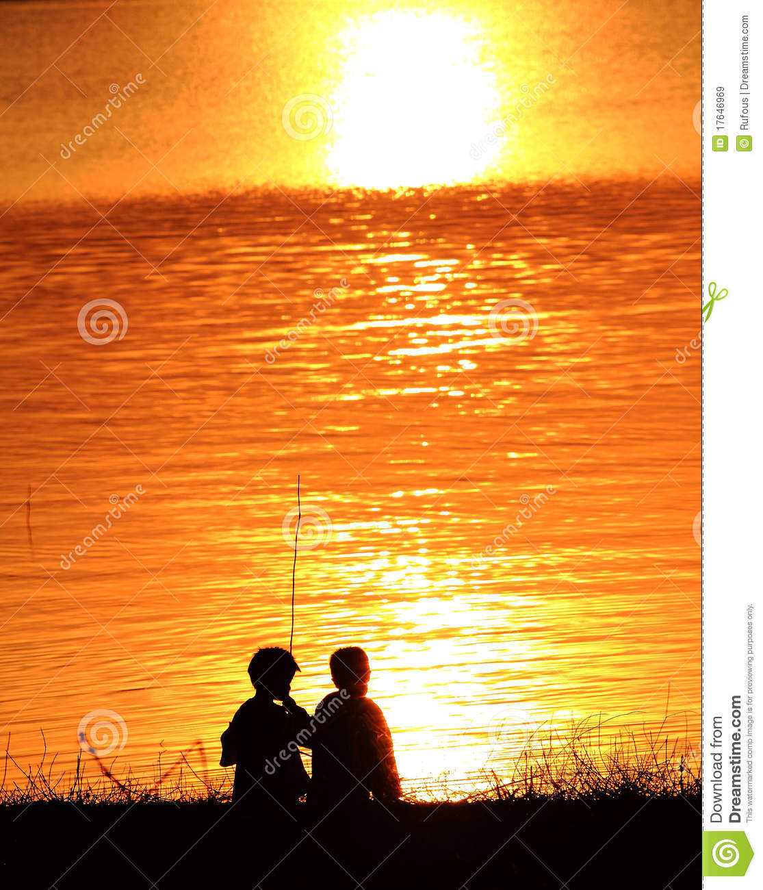 Silhouettes Of Two Children Playing On The Beach A Stock