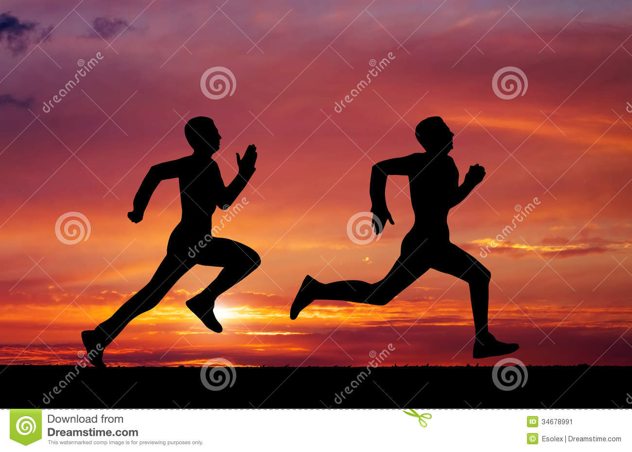 silhouettes of two runners stock image