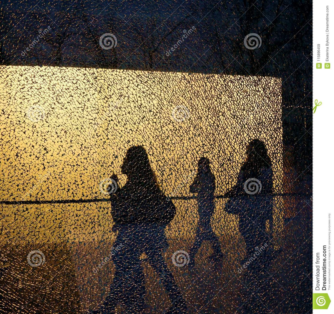 Silhouettes of walking people and trees seen through the broken window