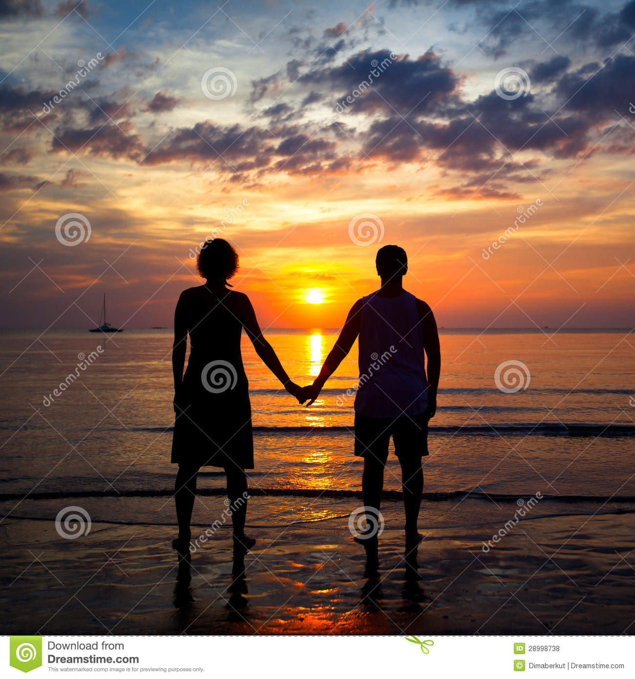 Silhouettes Young Couple On The Beach At Sunset Stock