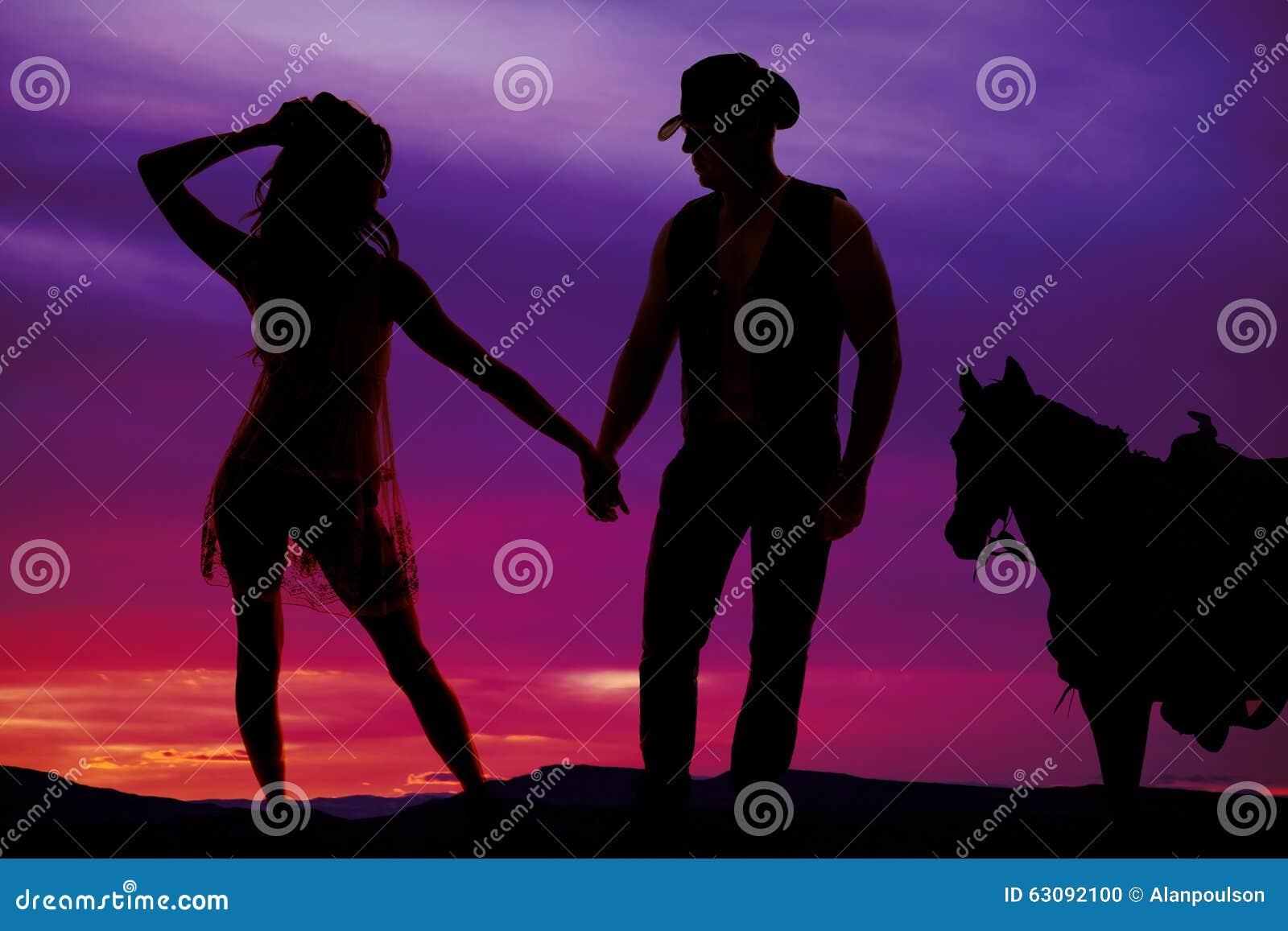 Download Silhouettez La Femme Dans La Robe Pure Avec Le Cowboy Et Le Cheval Photo stock - Image du isolement, tête: 63092100