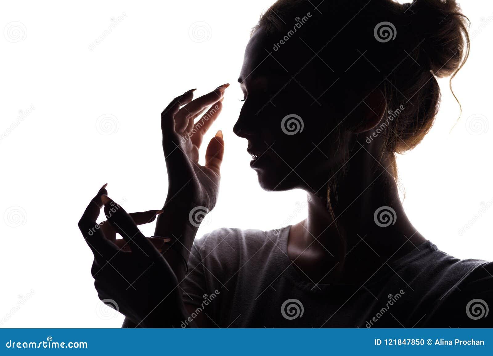 Silhouettieren Sie Porträt der Frau, Mädchengesicht auf Weiß lokalisiertem Hintergrund