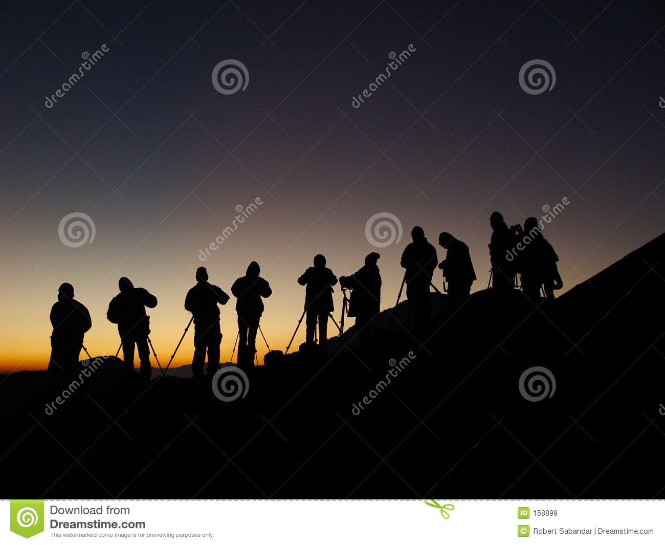 Silhoutte of Group of Photographers Shooting Sunrise