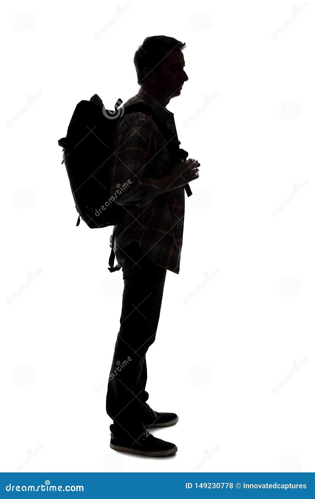 Silhueta de um caminhante ou de um guia tur?stica masculino