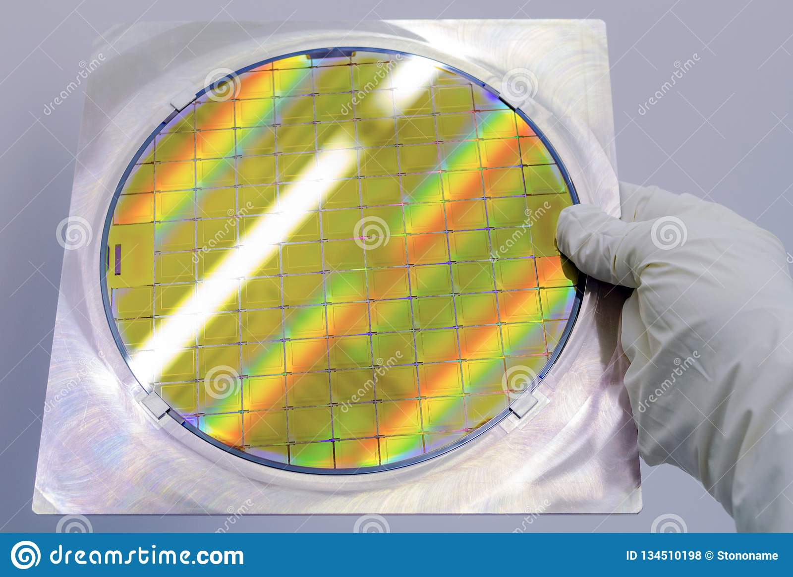 Silicon Wafer In Steel Holder Helds By Hand In Gloves - A
