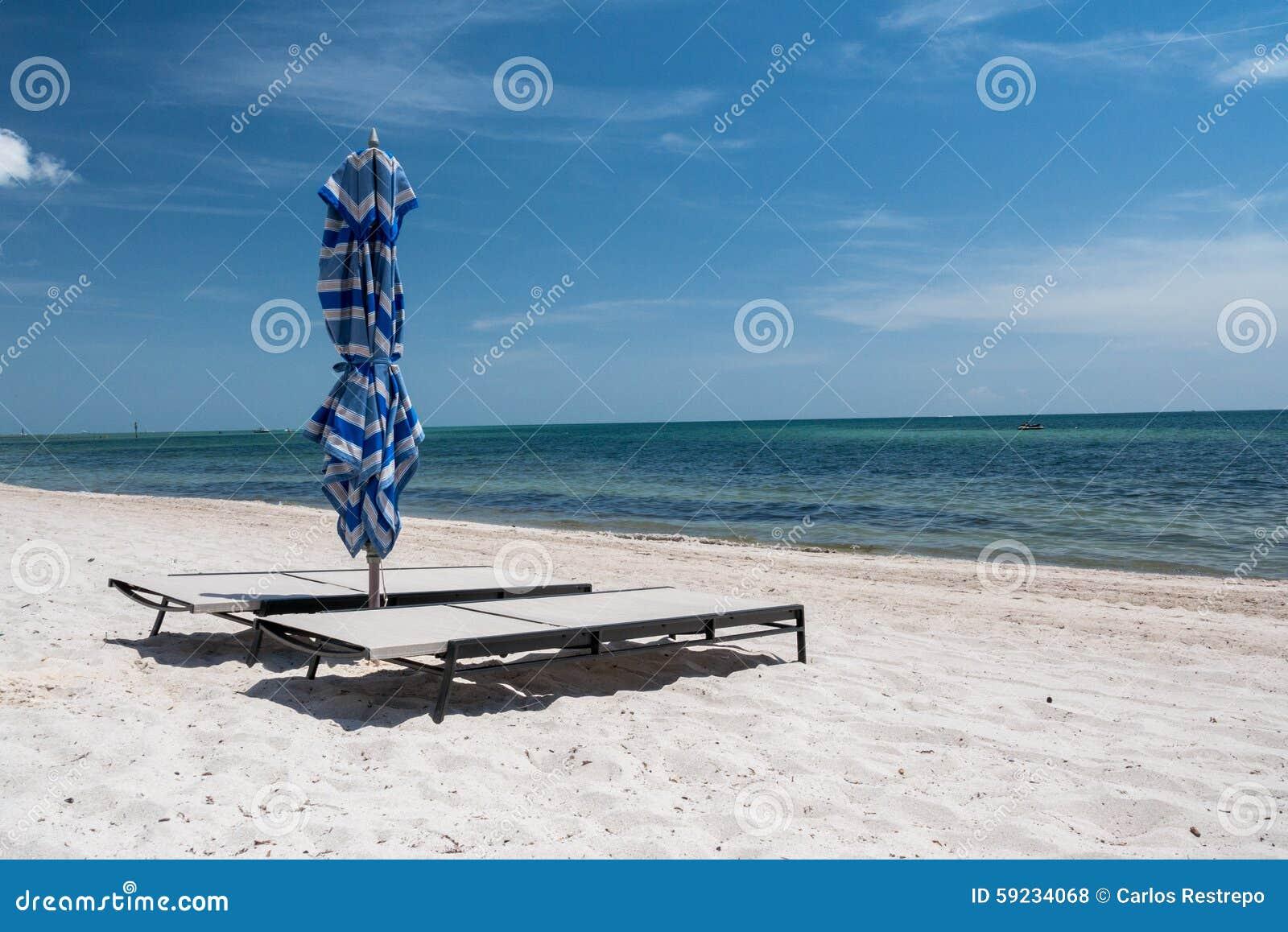 Download Sillas de playa foto de archivo. Imagen de playa, costa - 59234068