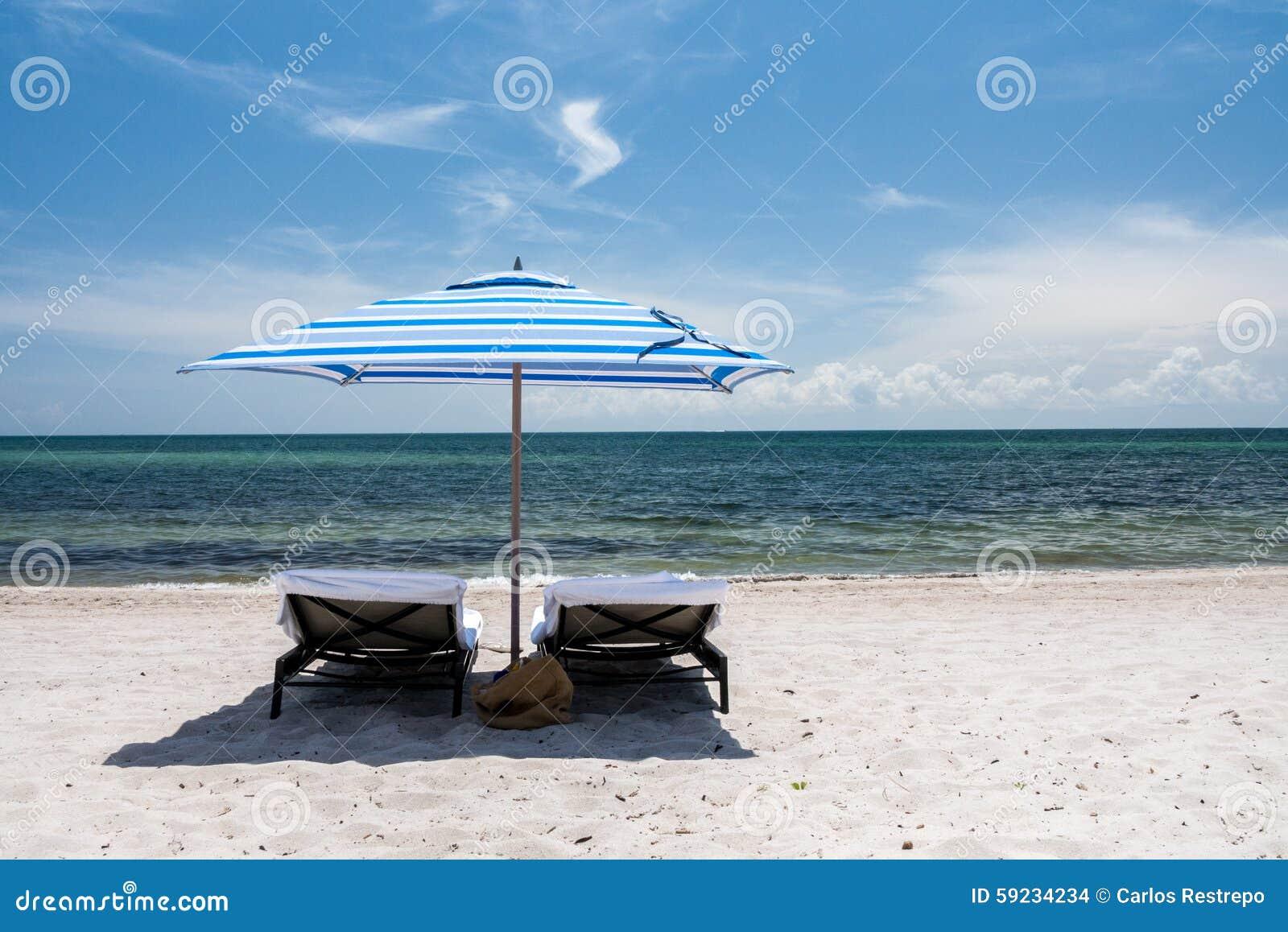 Download Sillas de playa foto de archivo. Imagen de caribbean - 59234234