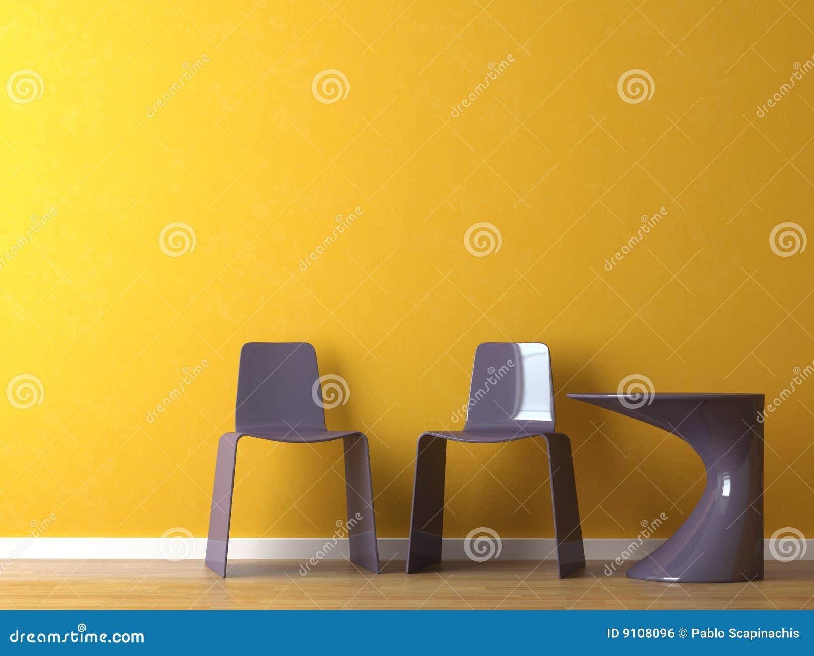 Sillas modernas del diseño interior en la pared anaranjada