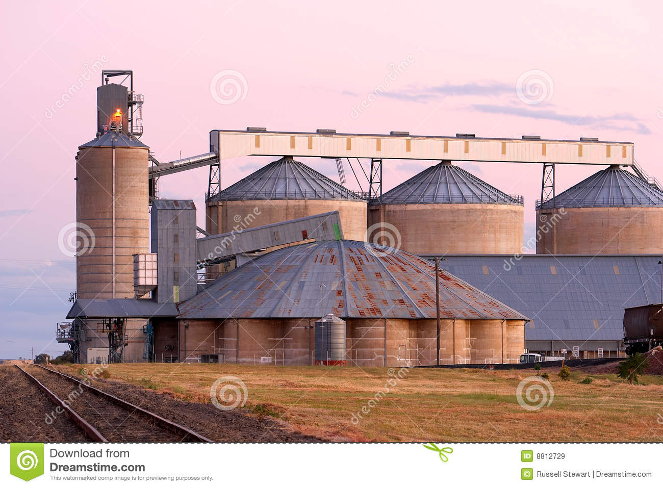 Silos bathed in pink after sunset light