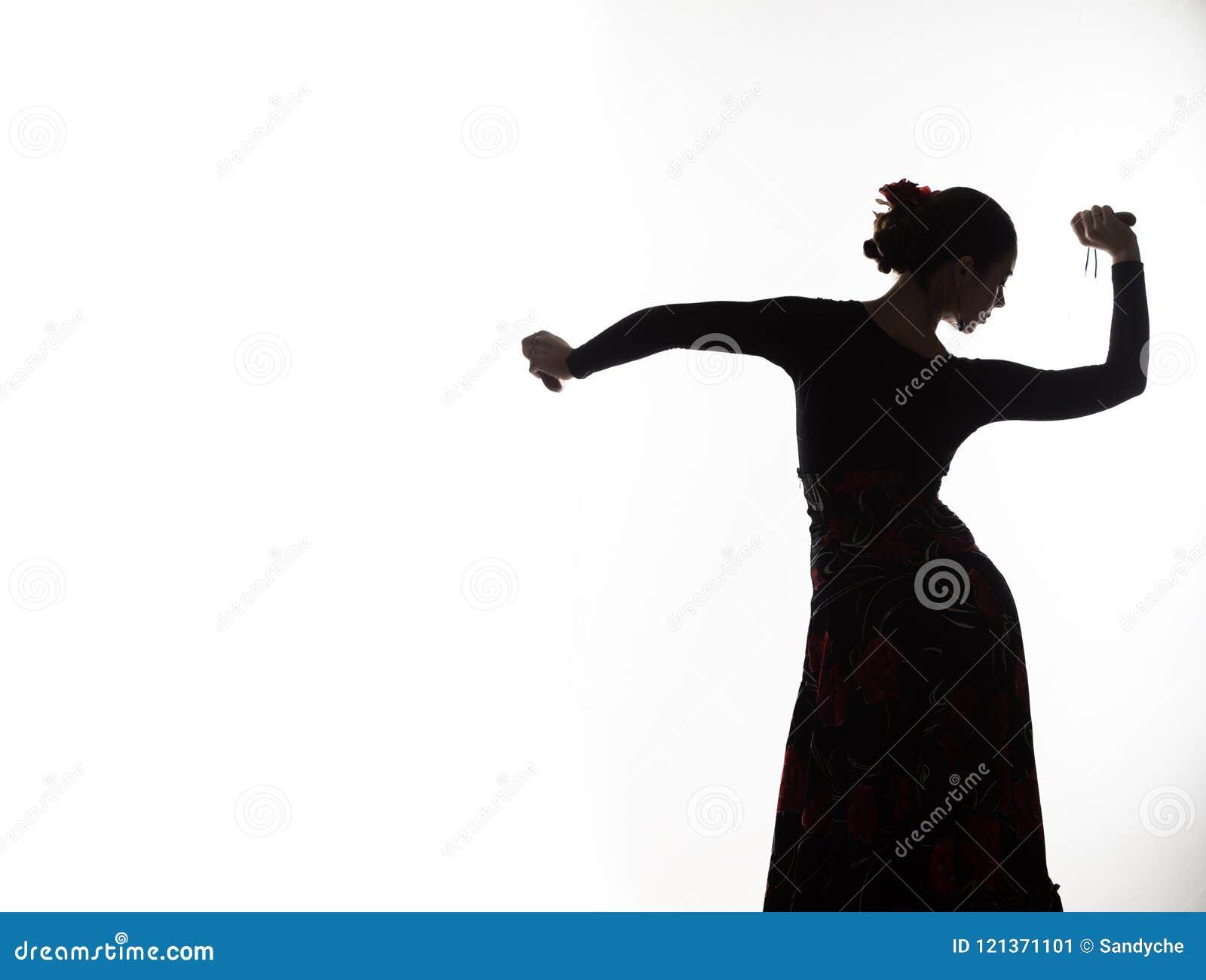 Siluetta del ballerino spagnolo di flamenco della ragazza su un fondo leggero Spazio libero per il vostro testo