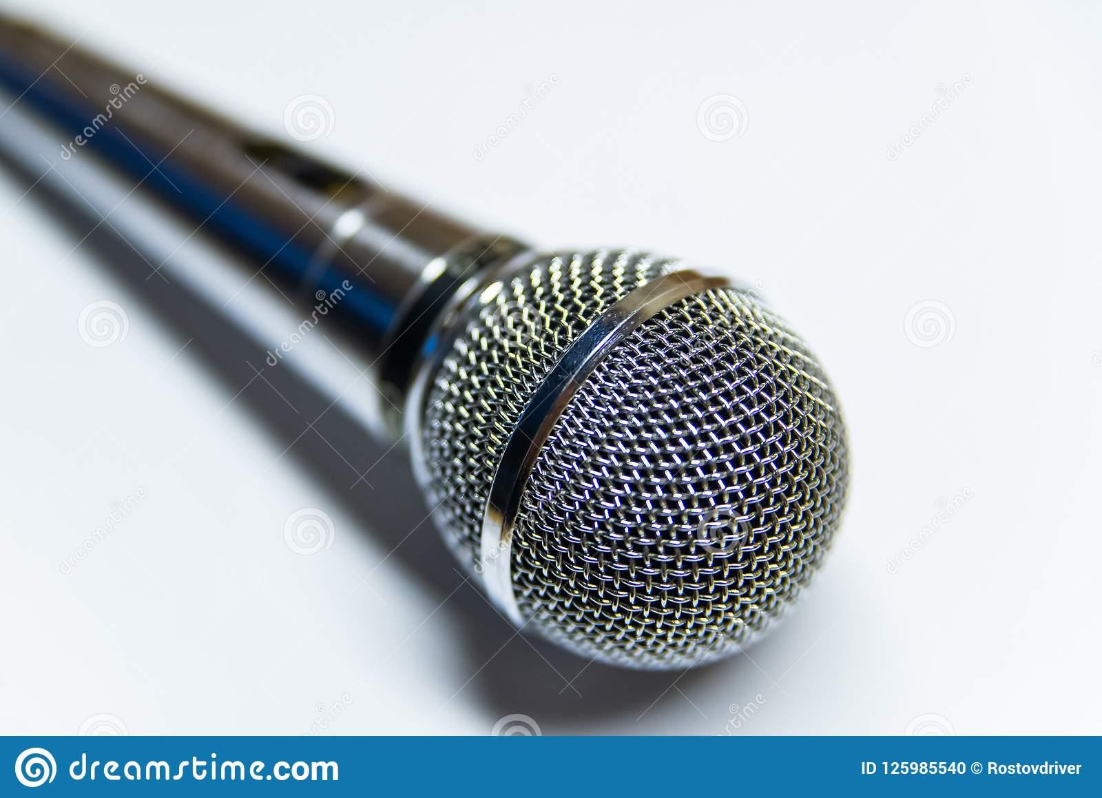Silver audio microphone on white background