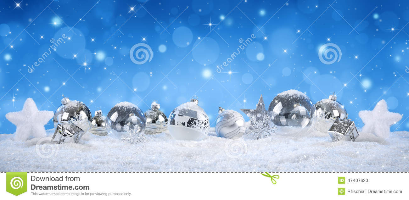 Silver balls on snow with snowfall