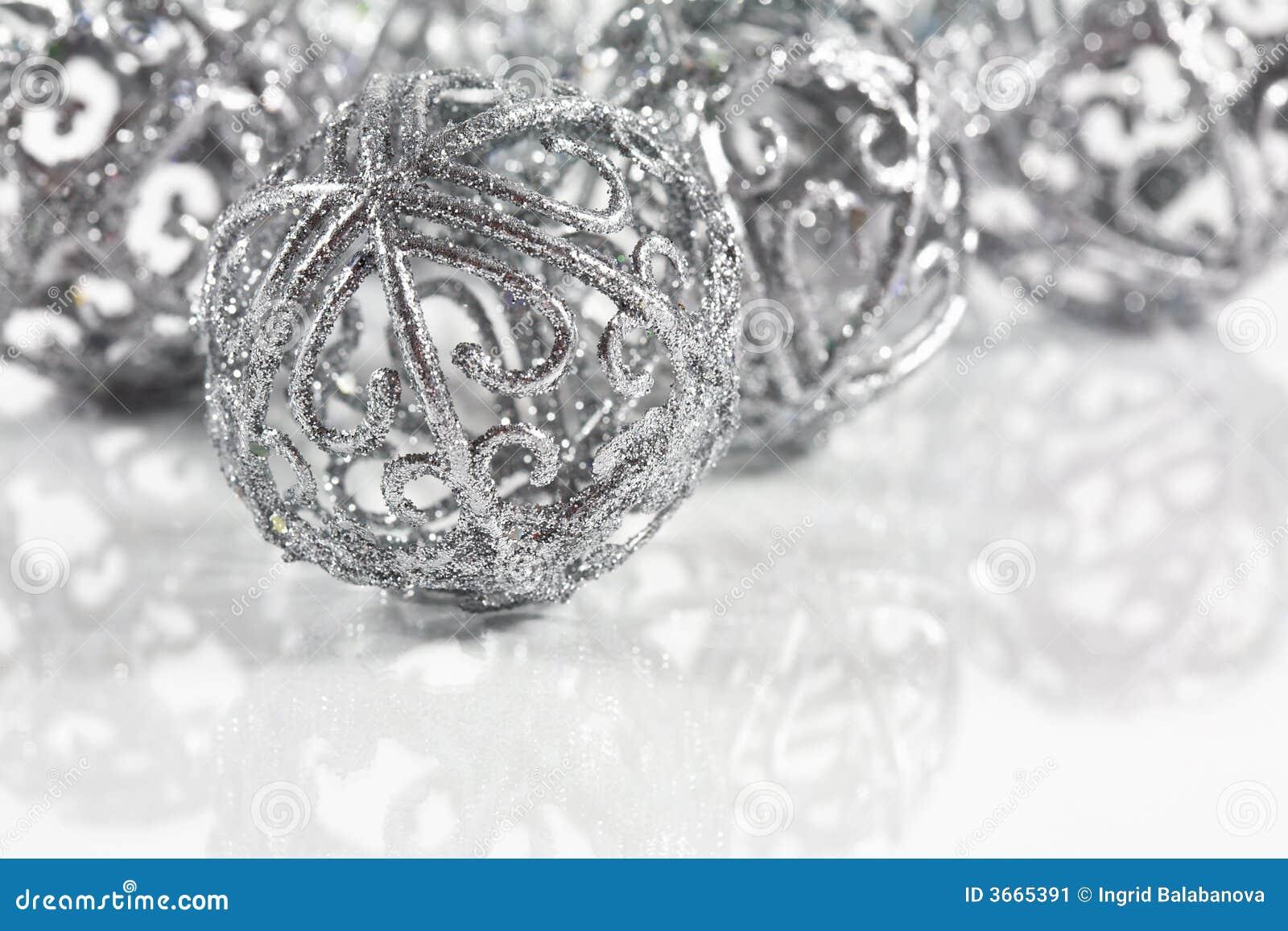 Silver balls on white background